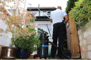 Cleaning gutters safely with SkyVac